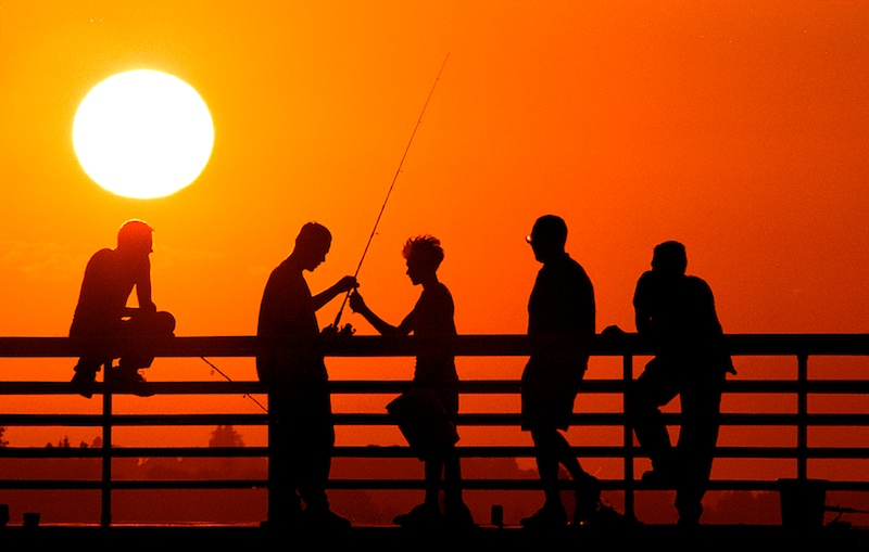 Fishermen with a setting sun